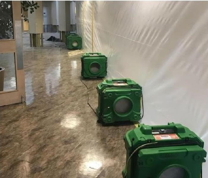 SERVPRO drying equipment in water damaged commercial building